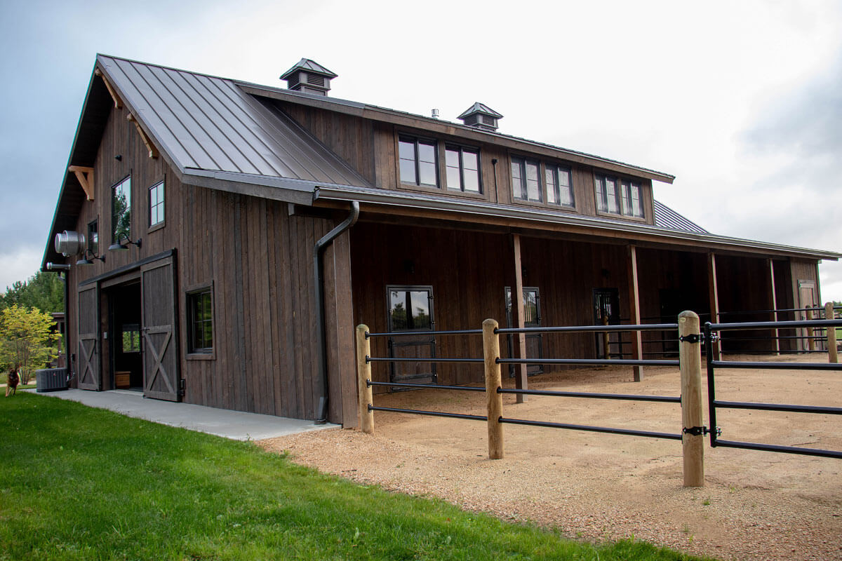 Twin Cities New Construction Barn Pros Equestrian Barn Stillwater Minnesota exterior rear view built by Red Pine Builders
