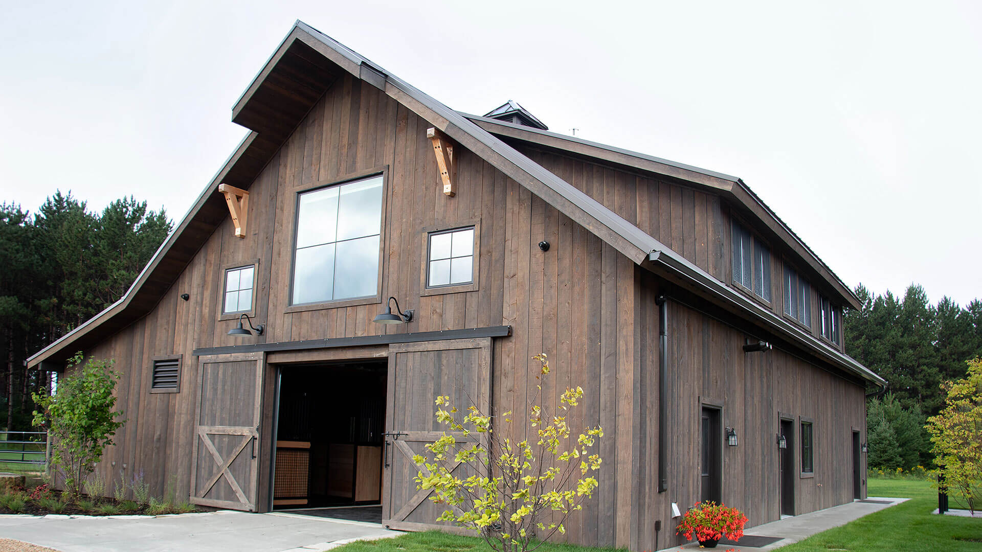 Twin Cities New Construction Barn Pros Equestrian Barn Stillwater Minnesota front view with barn doors open built by Red Pine Builders