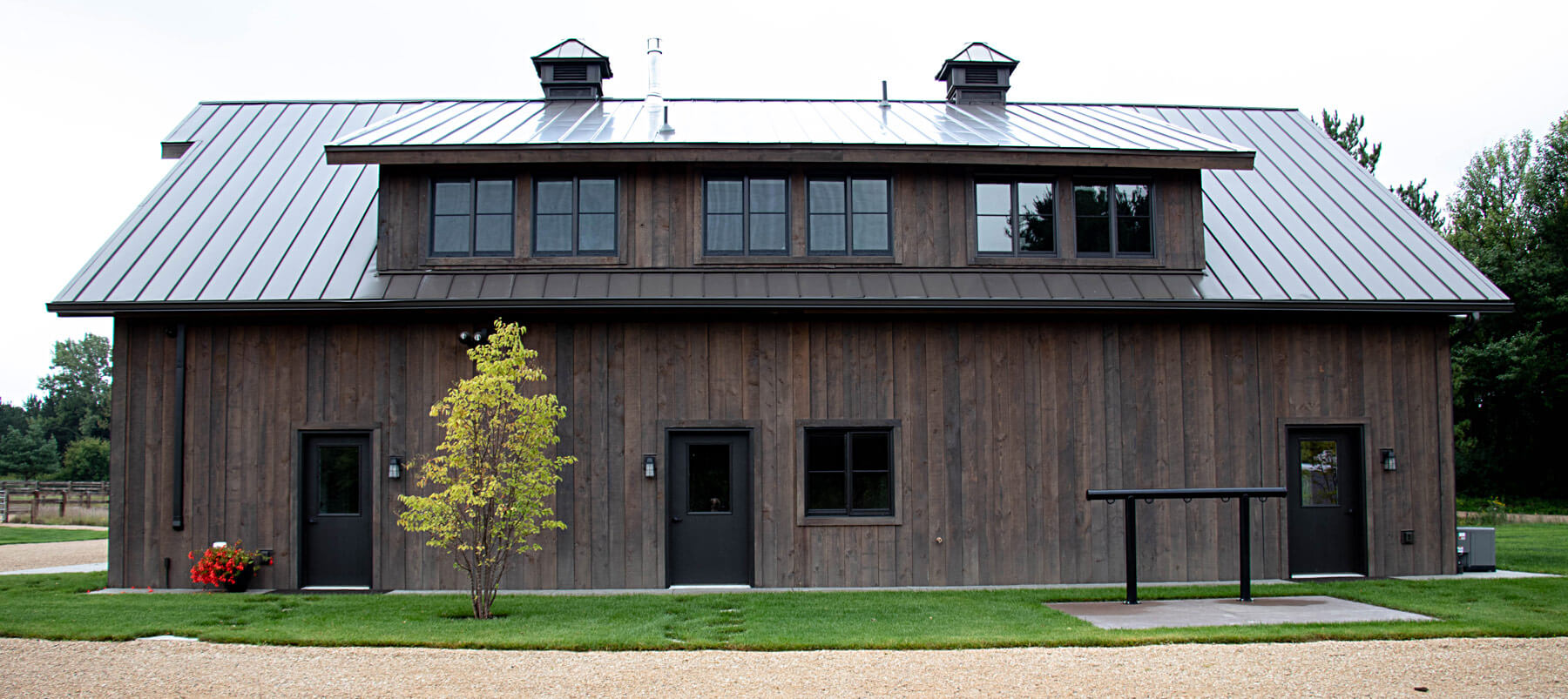 Twin Cities New Construction Barn Pros Equestrian Barn Stillwater Minnesota exterior side view built by Red Pine Builders