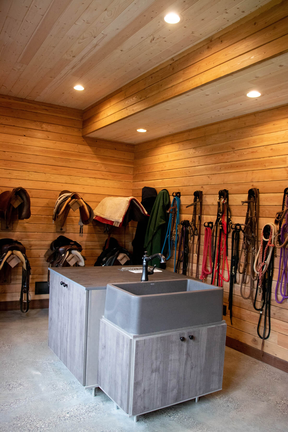Twin Cities New Construction Barn Pros Equestrian Barn Stillwater Minnesota interior sink and storage built by Red Pine Builders