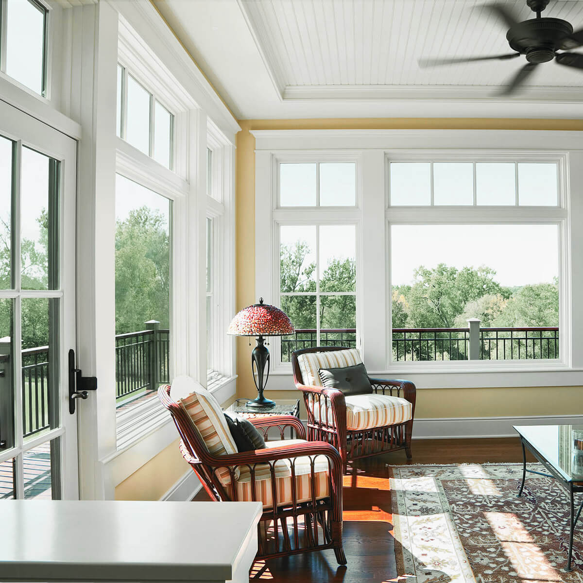 Andersen Windows A-series casement windows, picture windows, and hinged patio door in 4-season porch addition