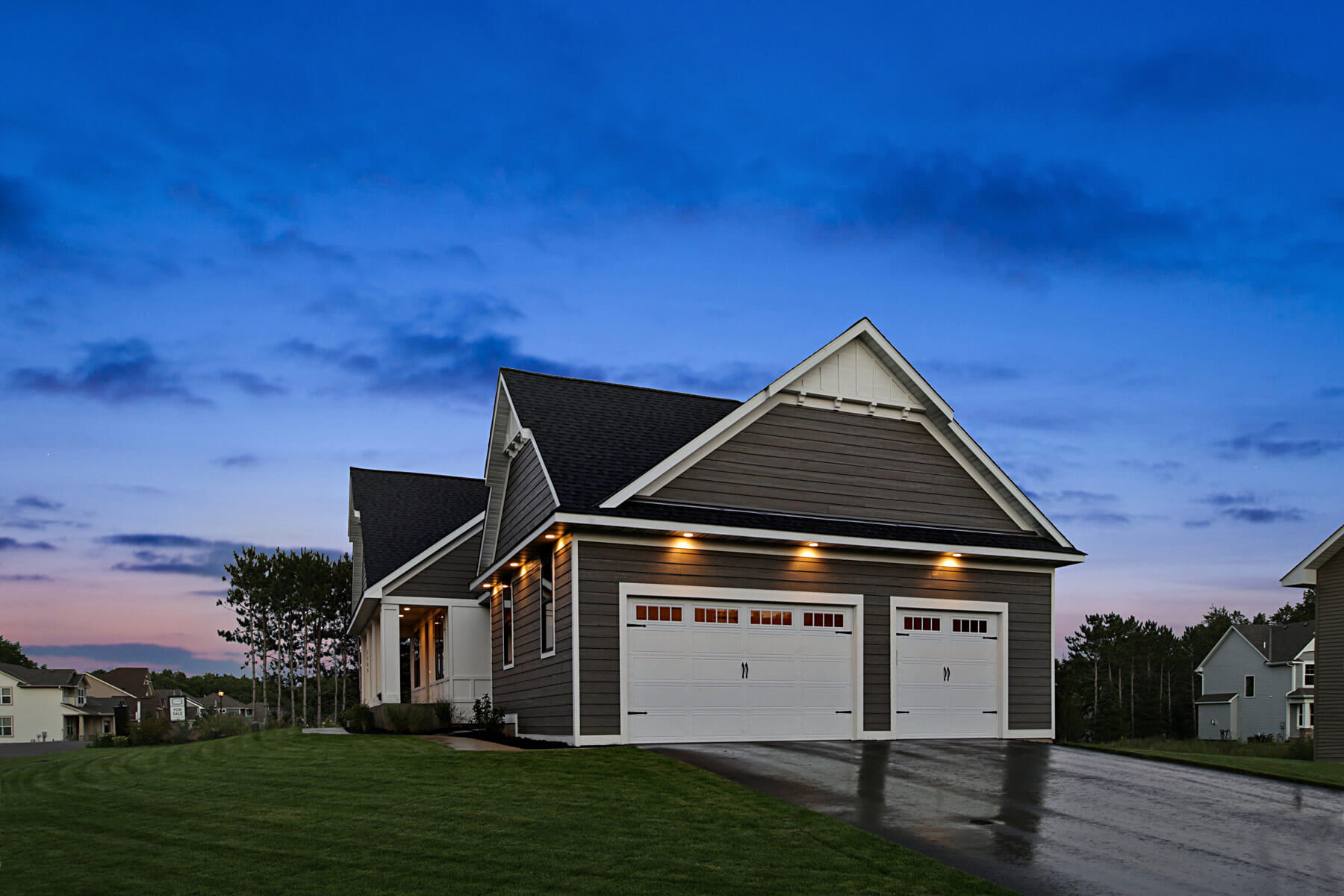 Twin Cities New Construction Monterey Court Home Stillwater Minnesota exterior 3-car garage built by Red Pine Builders